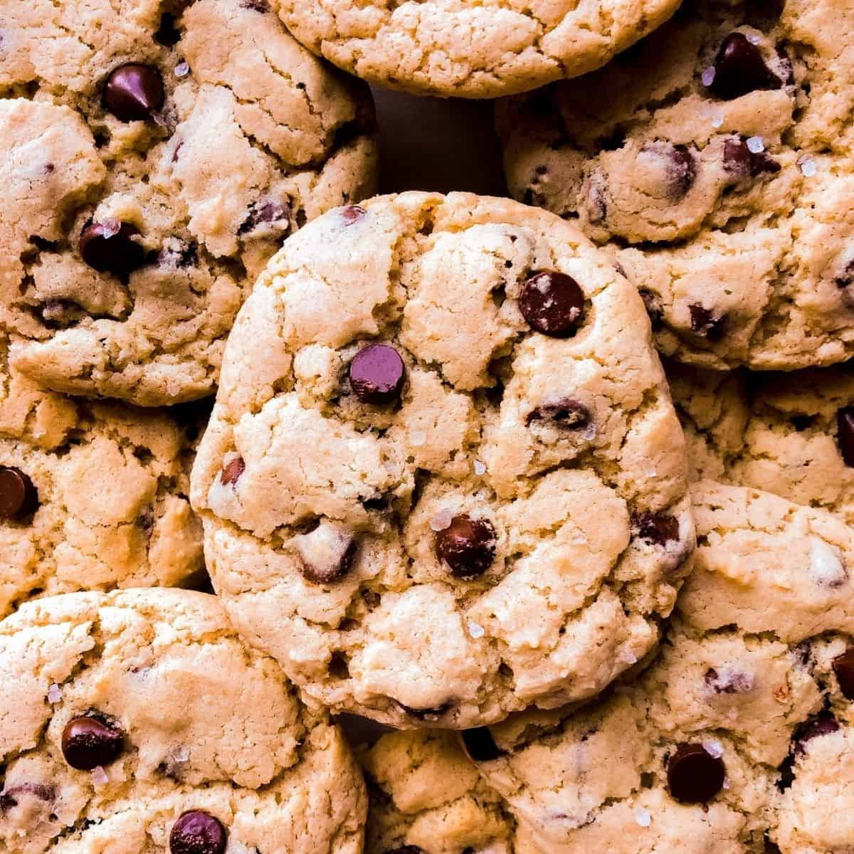 a pile of gluten free vegan chocolate chip cookies up close