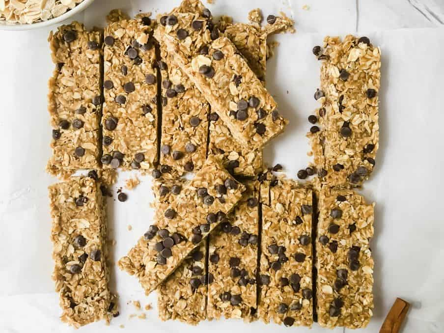 nut free granola bars on a white parchment paper with chocolate chips // livingbeyondallergies.com