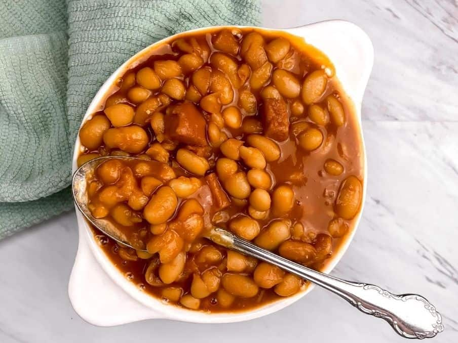 easy baked beans in a bowl with a spoon on a marble top // livingbeyondallergies.com